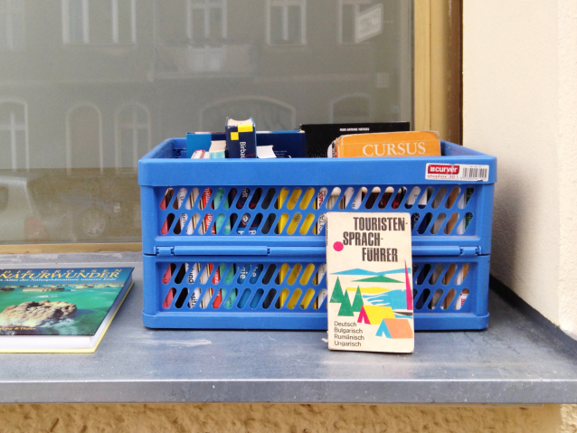 Crate of free books on a windowsill