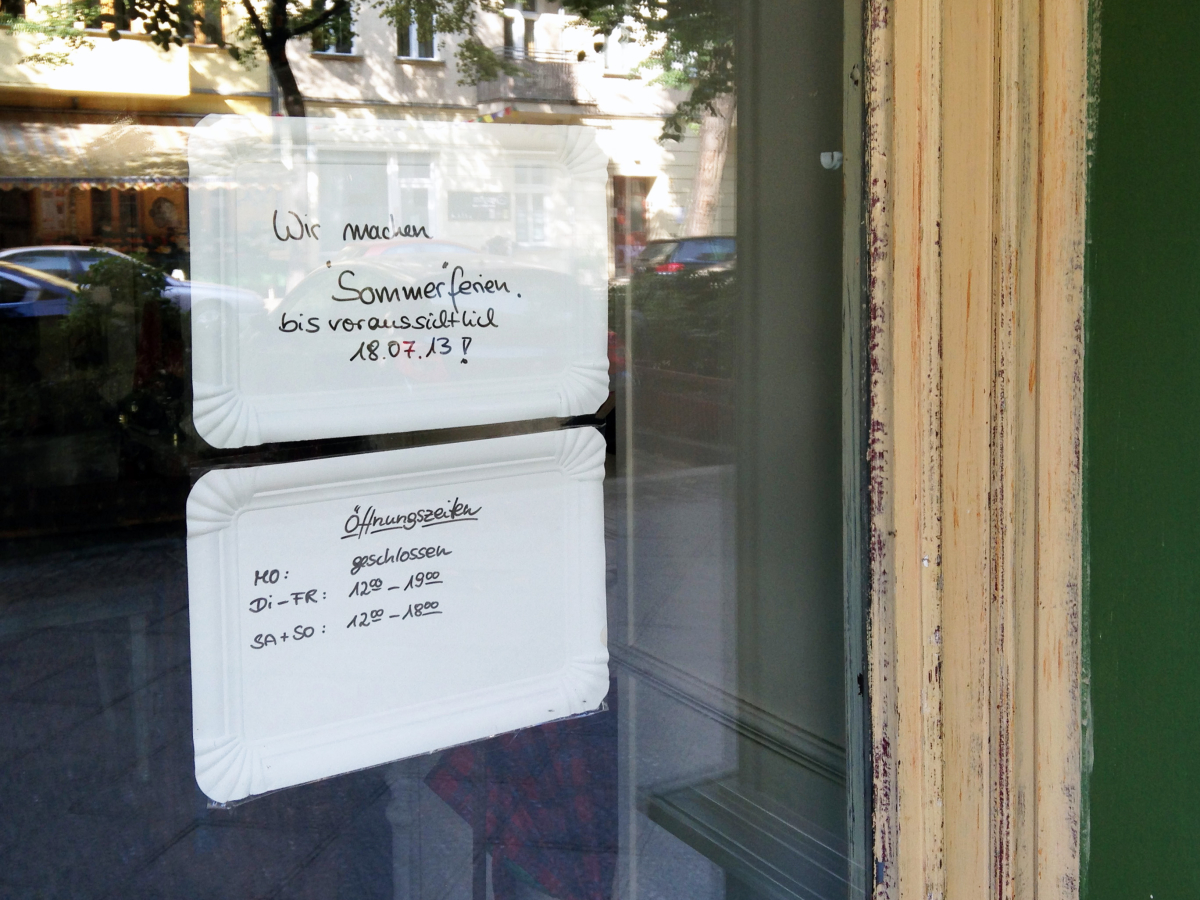 Two signs in window made of paper take-out tray