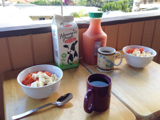Breakfast table in Honolulu with local bananas, papaya and milk