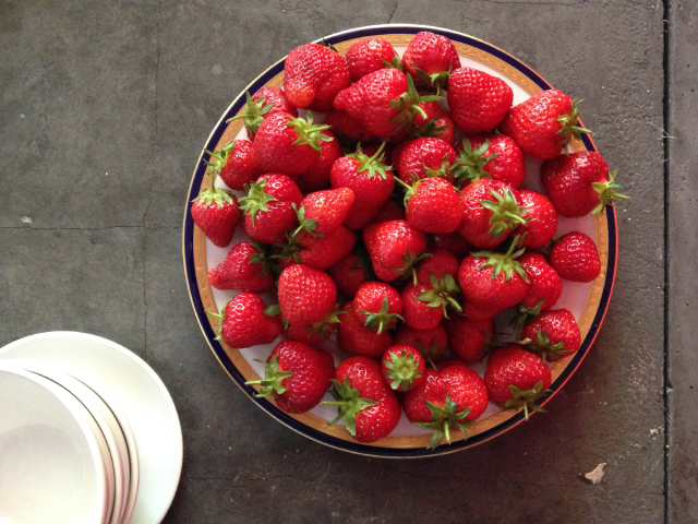 Plate of strawberries on a tabletop