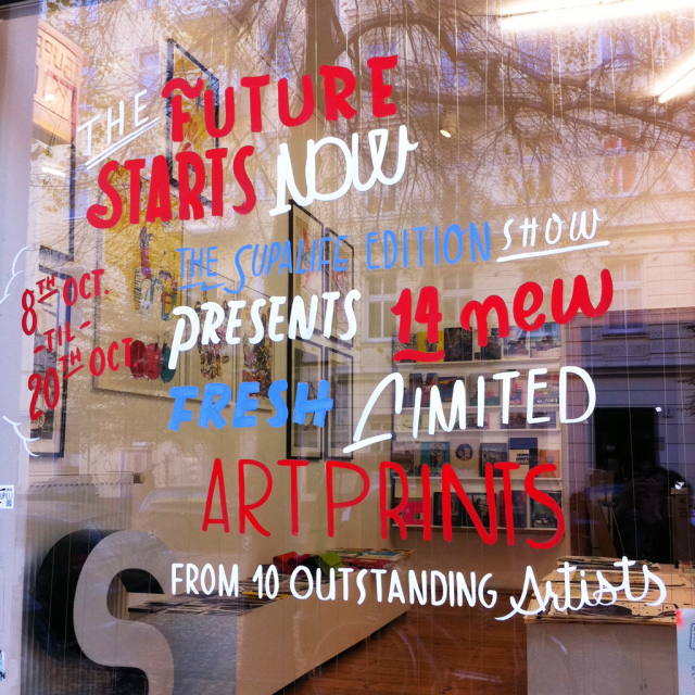 Hand painted window lettering at a gallery