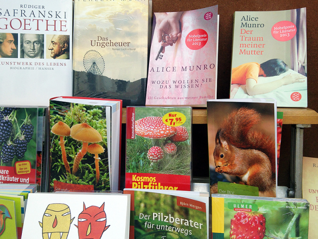 "Display of German books, including mushroom guides and two Alice Munro books with stickers reading ""Nobelpreis Literatur 2013"""