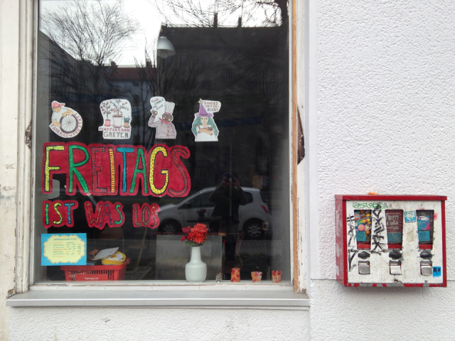 "Storefront window with colorful paper letters ""Freitags ist was los"""