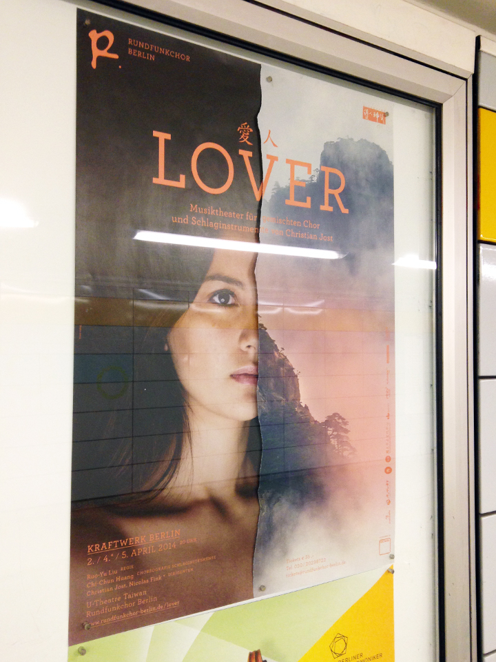 Poster in display case made of two ripped halves (woman's face, mountain)