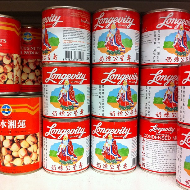 "Stacked cans of Chinese condensed milk reading ""Longevity"""