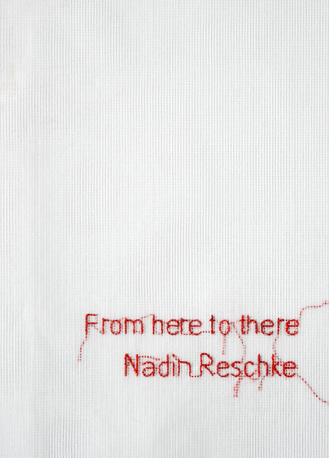 Embroidered text on book cover