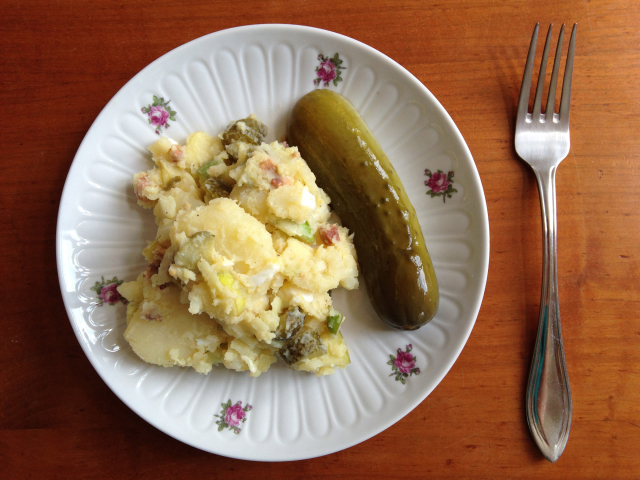 Plate of potato salad with pickle