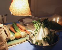 Vegetables under rough brown-paper lampshade