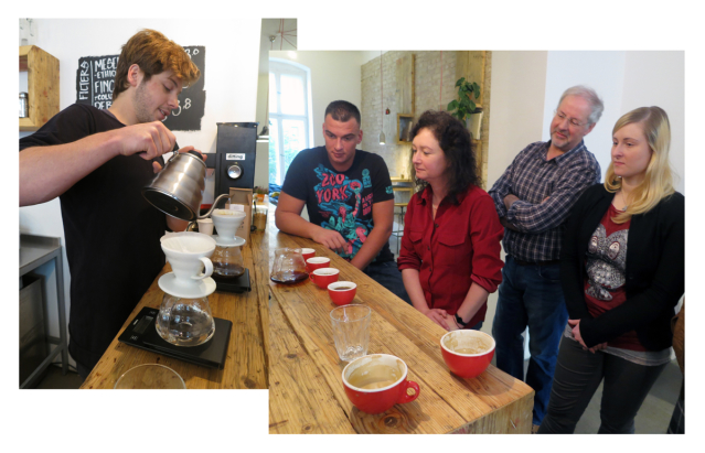 Barista pours water into coffee filter as four guests watch